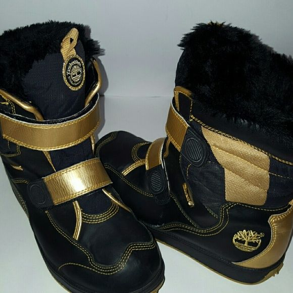 "Timberland Rugged Snow Stomper  Boots ! ""HOT"" Black & Gold Timberland Rugged ,Snow Stomper ankle  Boots ! Unisex , Size 7 Men , Size 9 Women ! Very warm & comfy fur inside. Great used condition . Insulated , waterproof , Velcroe straps , gold Timberland on tounge of boot on back heel is logo & Timberland engraved plate. Any Q's just tag me. Will trade for a size 9-10 UGG Boots ! Thank you for peeking in my closet ! Timberland Shoes Winter & Rain Boots"