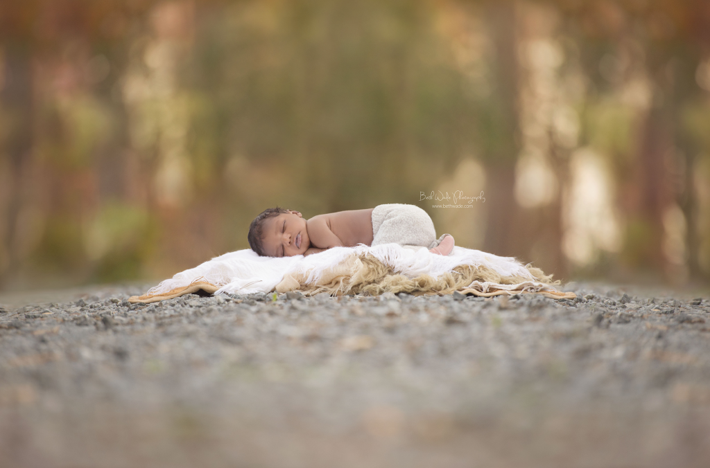 Baby boy sleeping outside charlotte nc outdoor newborn photography charlottenewbornphotographer bethwadephotography