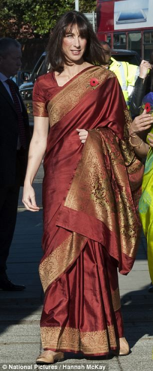 Nov, 2013: UK PM David Cameron wife Samantha dazzles in a spectacular autumnal Saree as they celebrated Diwali on visit to a Swaminarayan Temple in London