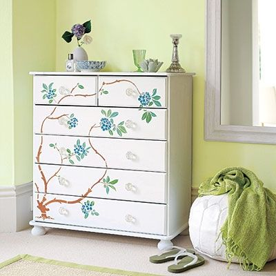 Plain dresser turned interesting with an adorable stencil design.
