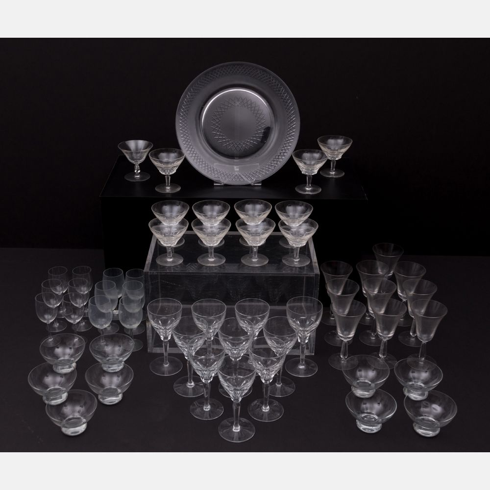 Lot 317 A COLLECTION OF CRYSTAL AND GLASS STEMWARE Est: $200 - $400 Description A Miscellaneous Collection of Crystal and Blown Glass Stemware, 20th Century. Largest dimensions: dia: 14 1/2 in. Condition Chip to one rim.