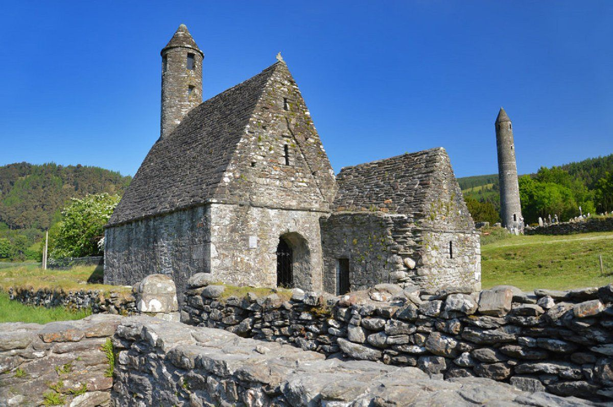 Saint Kevin Cathedral and Round Tower in the Background, Glendalough, Ireland.