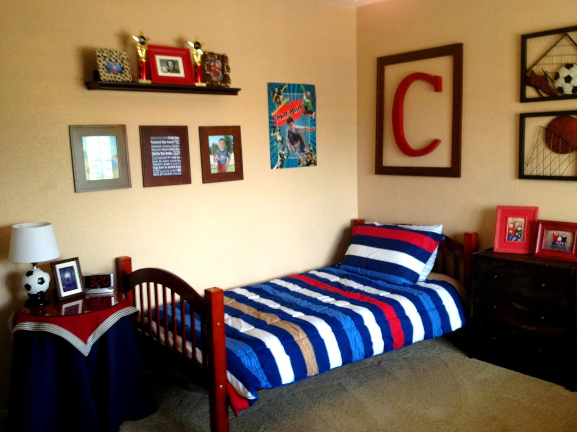 Boys bedroom designs sports - Red Blue Sports Themed Boys Bedroom With Blue Stripes Pillow And Bed Cover On Red Wooden