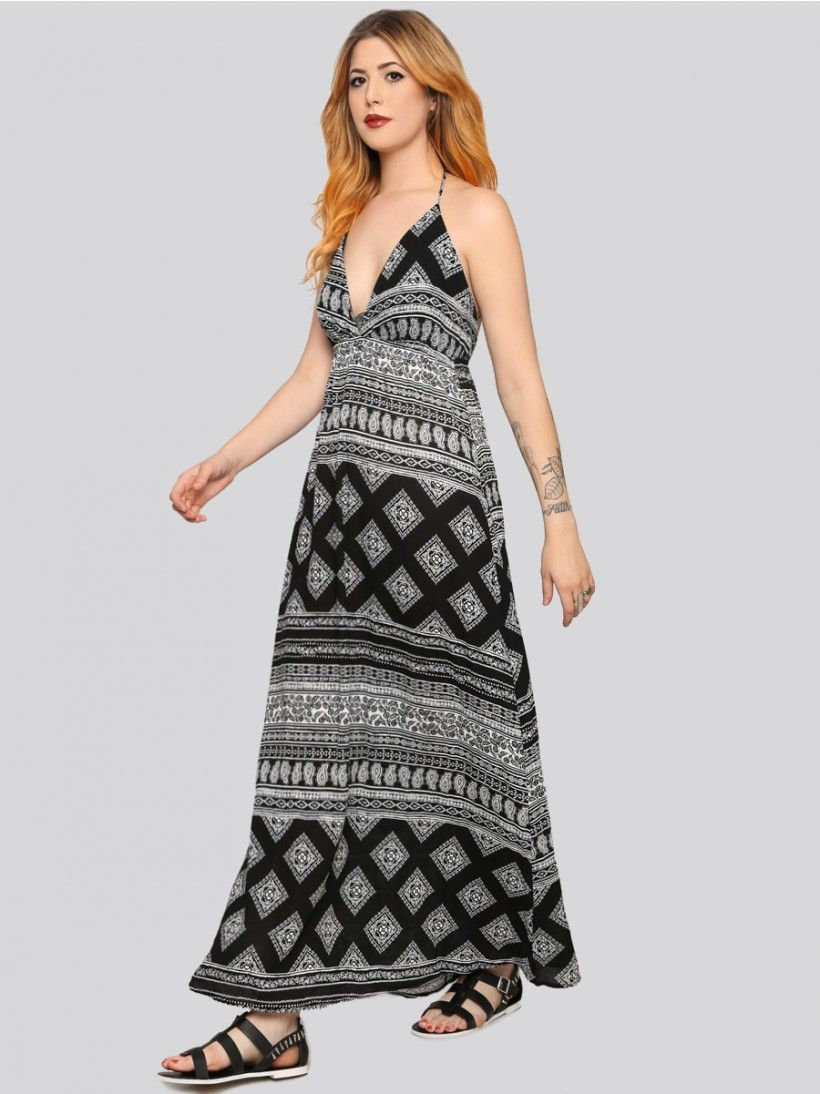 GYPSY WARRIOR Casual and chic maxi dress, featuring a triangle top design with a halter tie at the neck, open back, and an allover black and white bandana print. Lined at the bust.