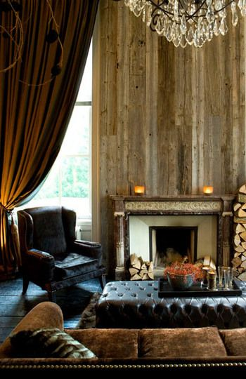 Salvaged wood paneling juxtaposed with sparkly chandelier.
