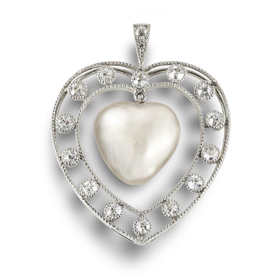 A rare natural heart-shaped pearl and diamond pendant