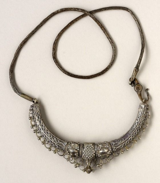 Necklace  Sri Lanka, 19th century  Jewelry and Adornments  Silver  Central section: Width: 3/4 in. (1.9 cm); Depth: 3 7/8 in. (9.84 cm); Chain length: 15 1/2 in. (39.37 cm)  Gift of Jerome L. Joss (M.85.286.6)  South and Southeast Asian Art