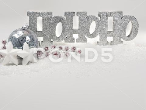 Seasons greetings with shiny HoHoHo message and festive decoration in the snow Stock Photos HoHoHomessageSeasonsshiny