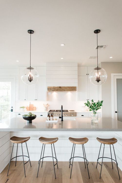 Photo of All White Glowing Kitchen with Crystal Bubble Pendant Lights and Industrial Wooden Counter Stools