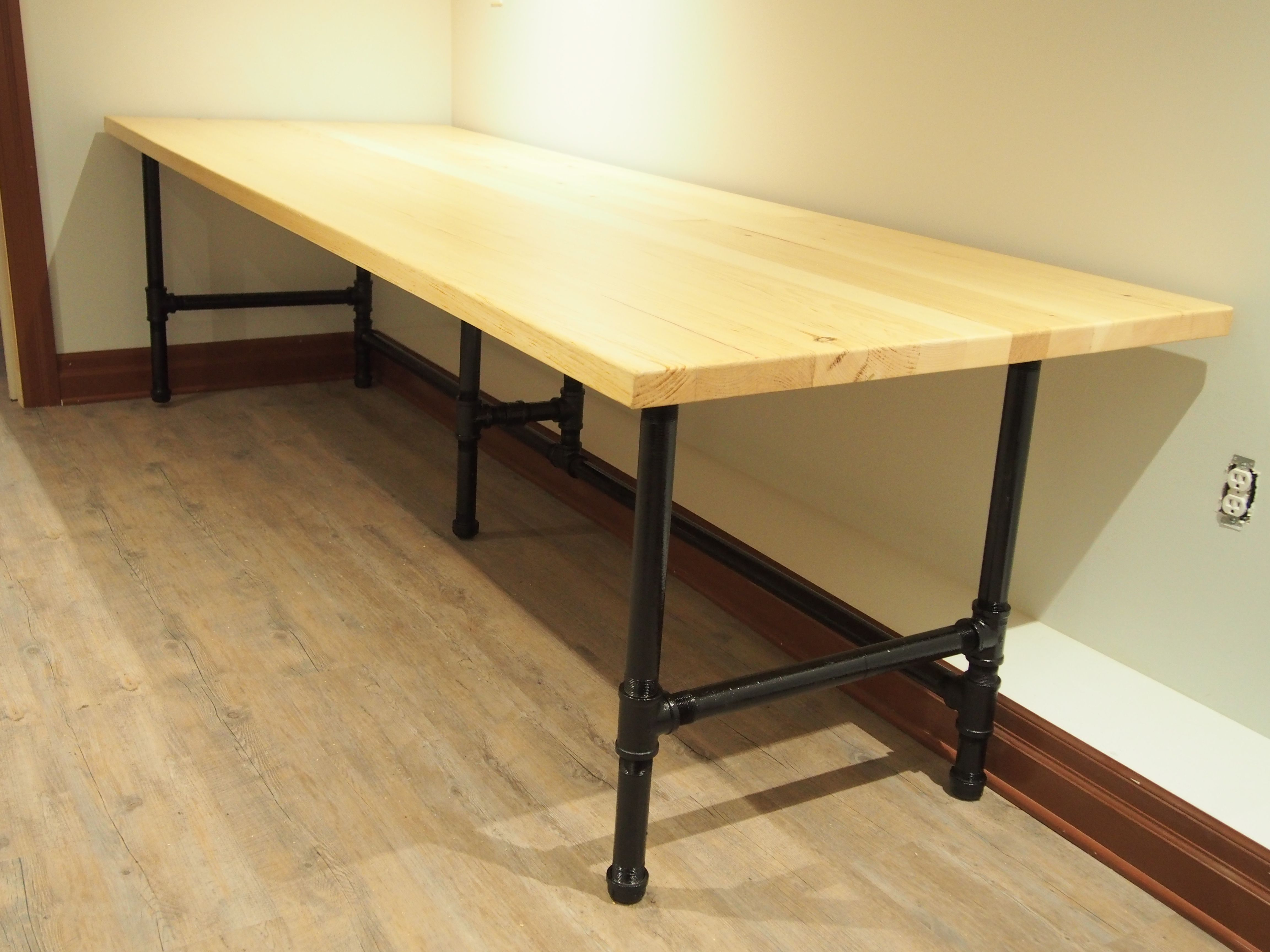 Long Computer Desk Made With Spare Metal Pipes And Wood Planks