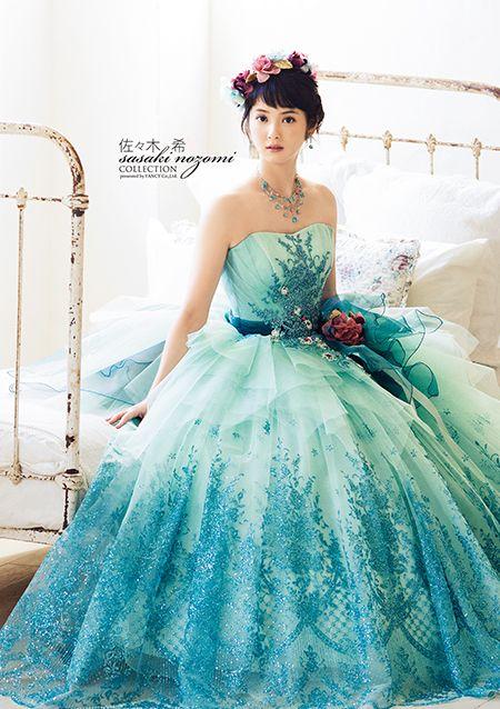 大人女子におすすめのキレイ色♡ターコイズブルーのウェディングカラードレスカタログ♡の2枚目の画像