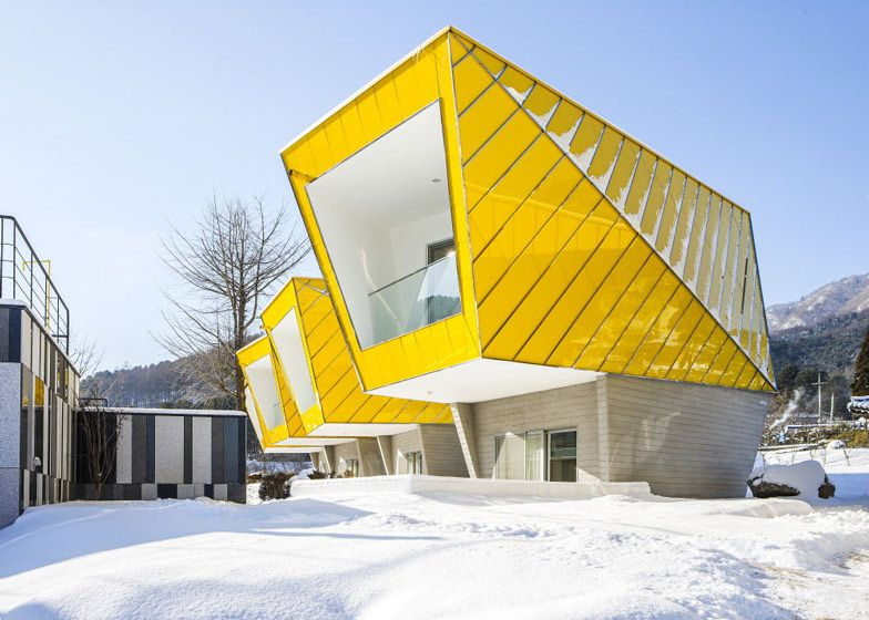 Asymmetric holiday homes by Studio Koossino with bright yellow walls