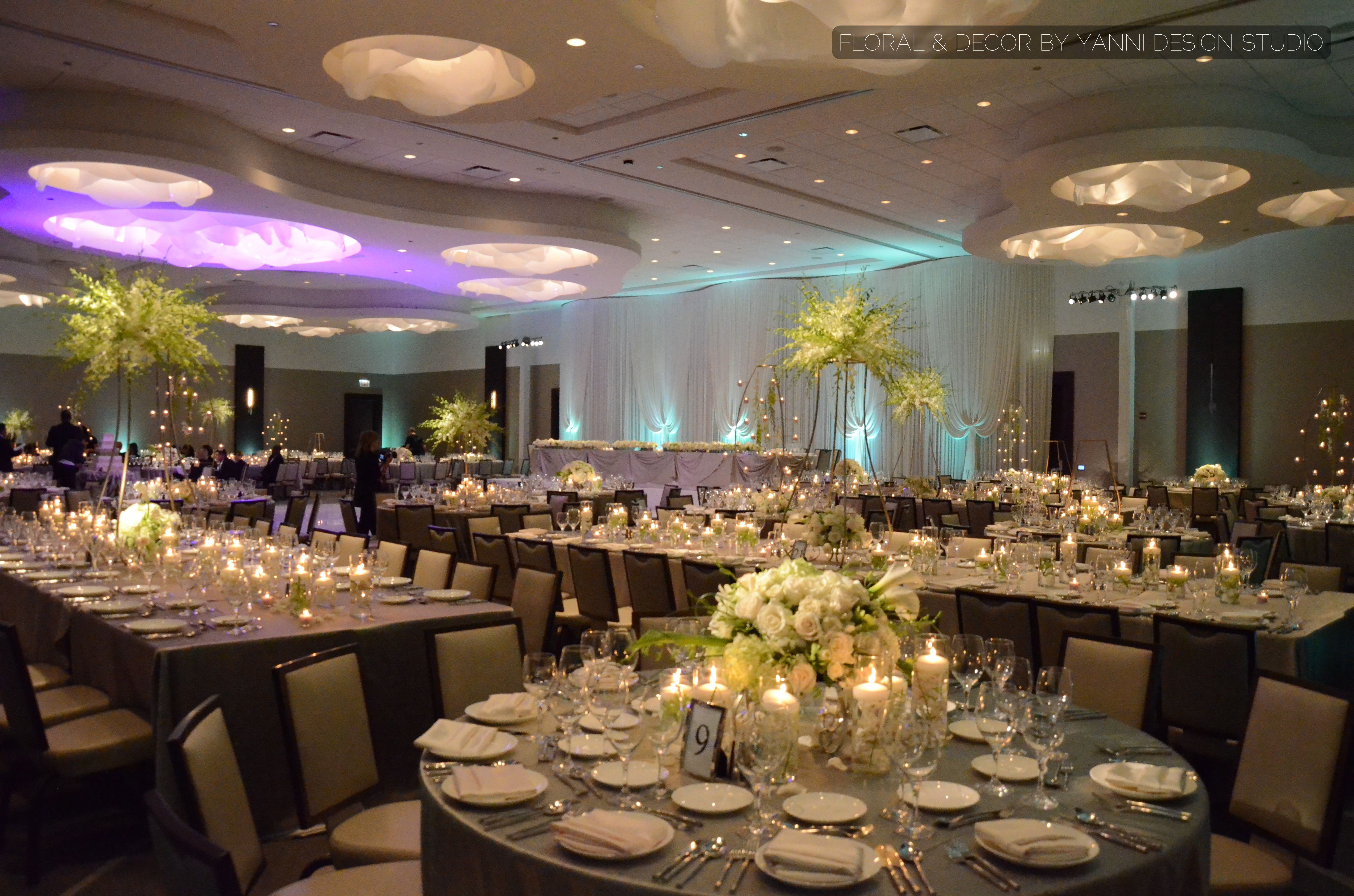 Modern Wedding Reception Decor With Floral Centerpieces In The Loews