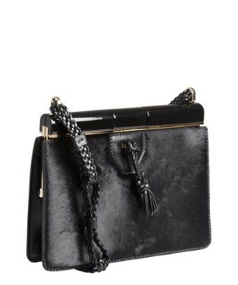 Adding a touch of luxe texture with this pony hair Tom Ford handbag will certainly up the ante of your outfit!