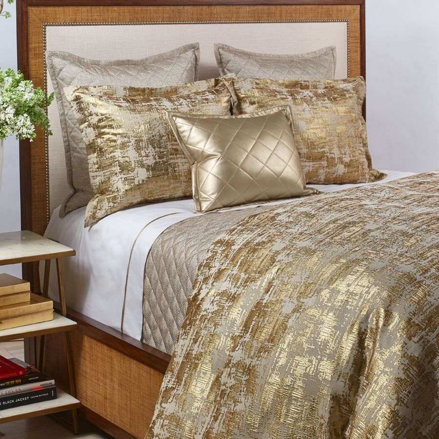 the scratch gold duvet set is layered with the raffia taupe coverlet set and a faux duvet