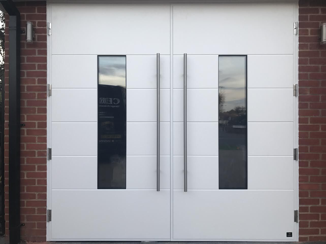 Our ultra modern side hinged garage doors can also be automated. & Our ultra modern side hinged garage doors can also be automated ... Pezcame.Com