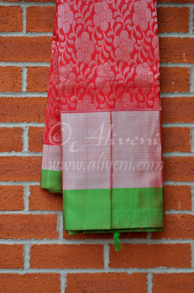 87783339f0 Tomato Red Kuppadam Pure Pattu Saree with Silver Floral Weaves all over and  Broad Green/Zari Border