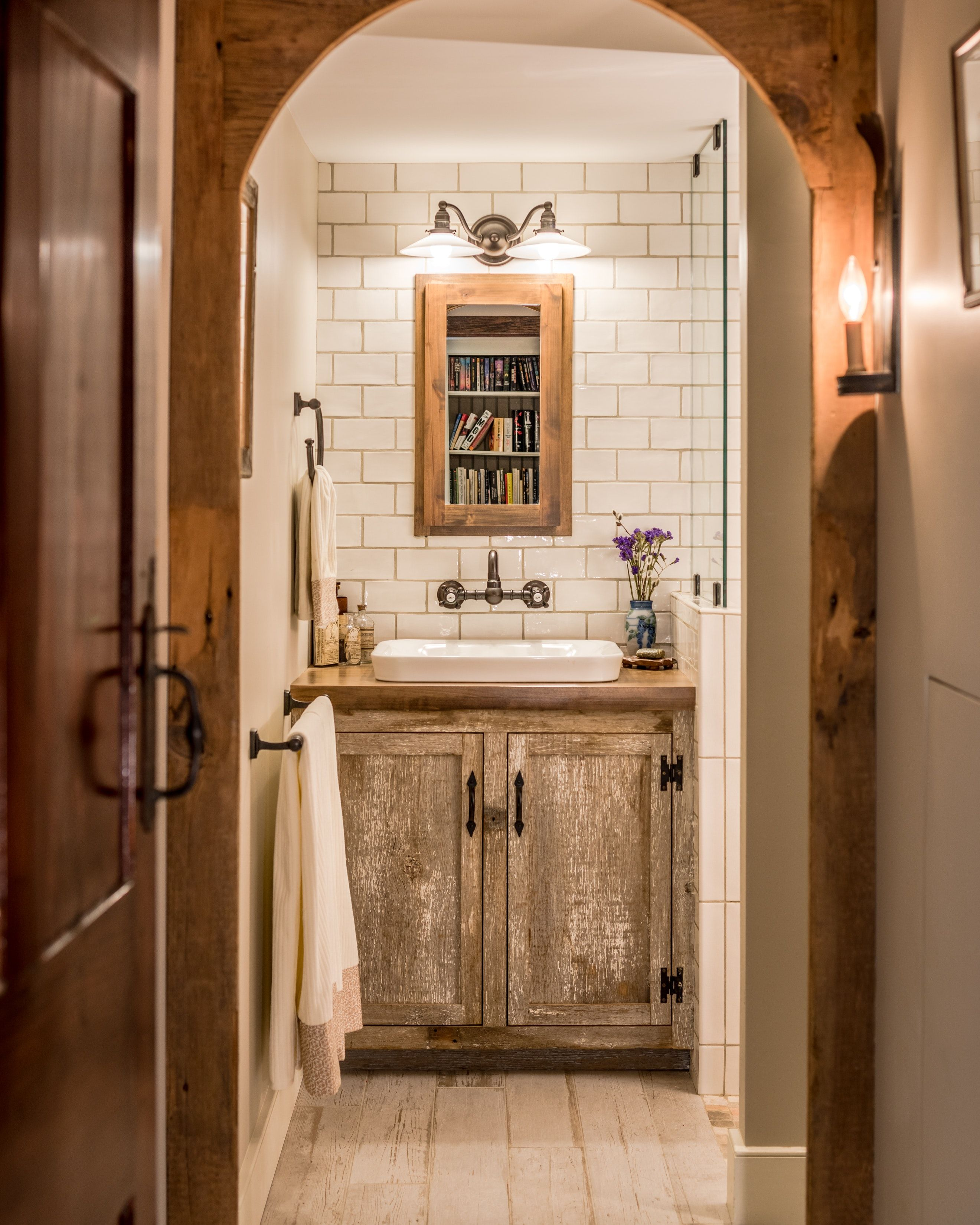 Rustic farmhouse bathroom with natural wood and white tile ...