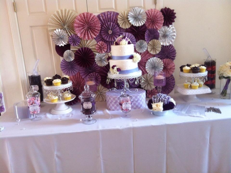 Dessert Cake Table Purple Theme With Pinwheel Decor In Background Purple Dessert Tables Bridal Shower Cupcakes Wedding Dessert Table