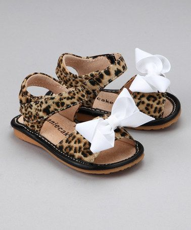 27905925b8 Take a look at this Leopard   White Bow Squeaker Sandal by Laniecakes on   zulily today!