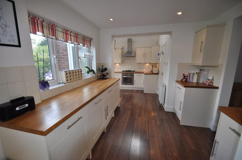 dark wood floor kitchen. Check out this photo of a orange wooden floor kitchen on Rightmove Home  Ideas pictures worktops and floors Kitchens