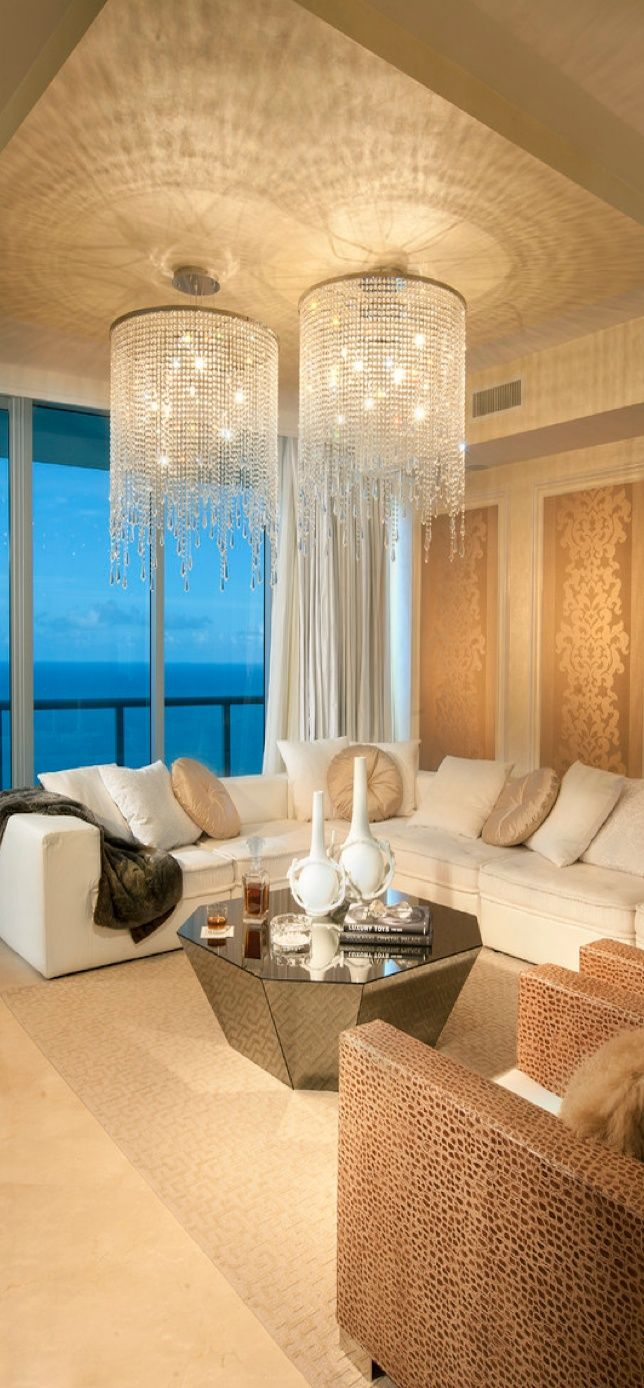 luxury living room with impressive chandeliers