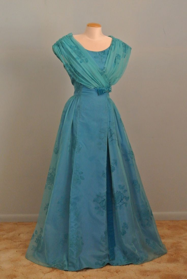 A vintage sleeveless blue evening prom gown evening gowns