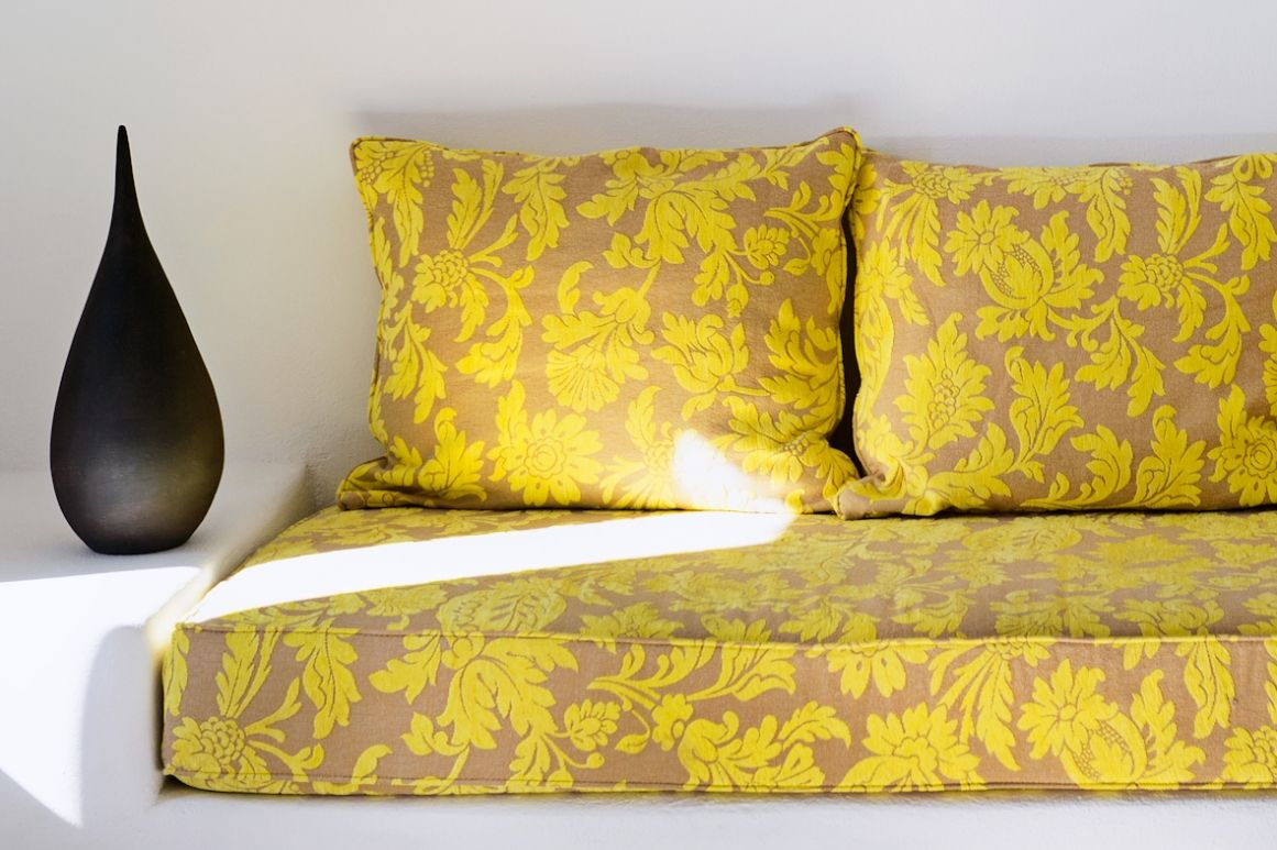 Yellow-BuiltSofa-Design-Livingroom-Pyrgos-Santorini-Island-Greece-VillaforRent