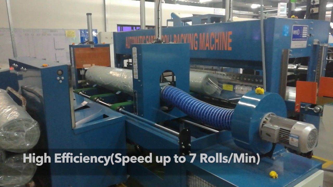 A fully automated Fabric Roll Wrapping Machine, running in