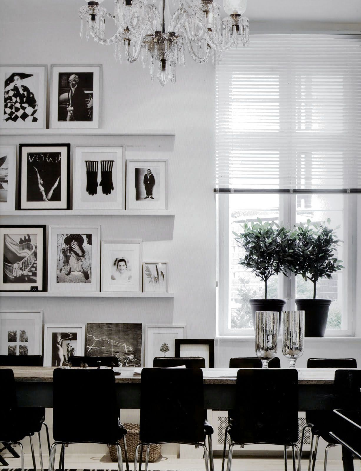 Stunning use of picture rails and mix and match frames with black and white photographs