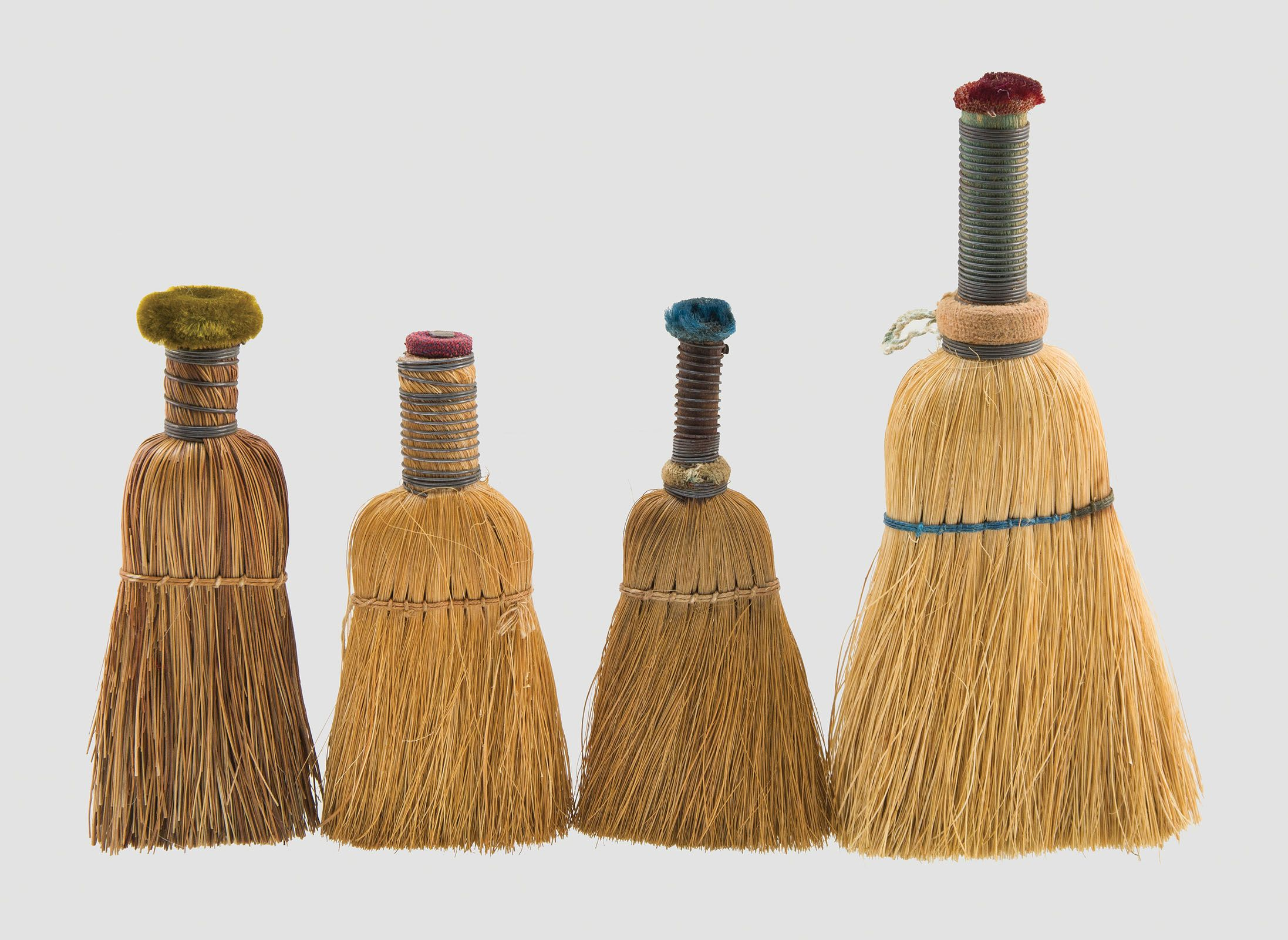 "Lot 59: Four ""Fancy Goods"" Whisk Brooms 