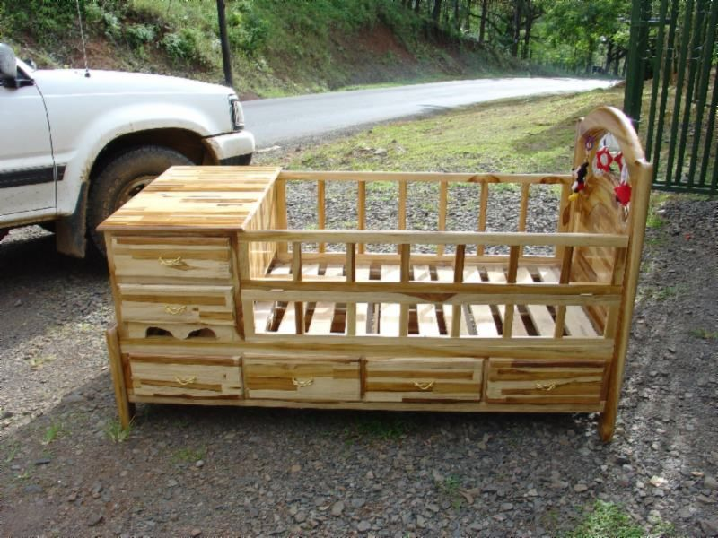 rustic+cribs+for+babies   This teak baby crib is the woodworker's own design. It has toys ...