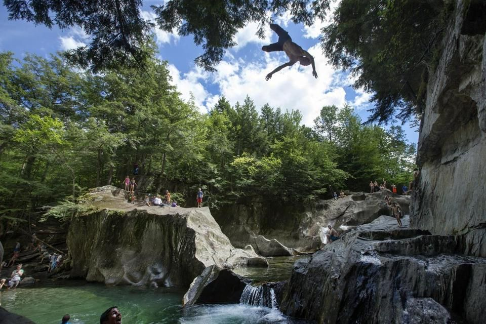 WARREN, VT---July 30, 2016-Globe Staff Photo by Stan Grossfeld-- The swimming hole at Warren Falls as Aiden Chmura,16, of Stowe does a dive from the top of the ledge. .