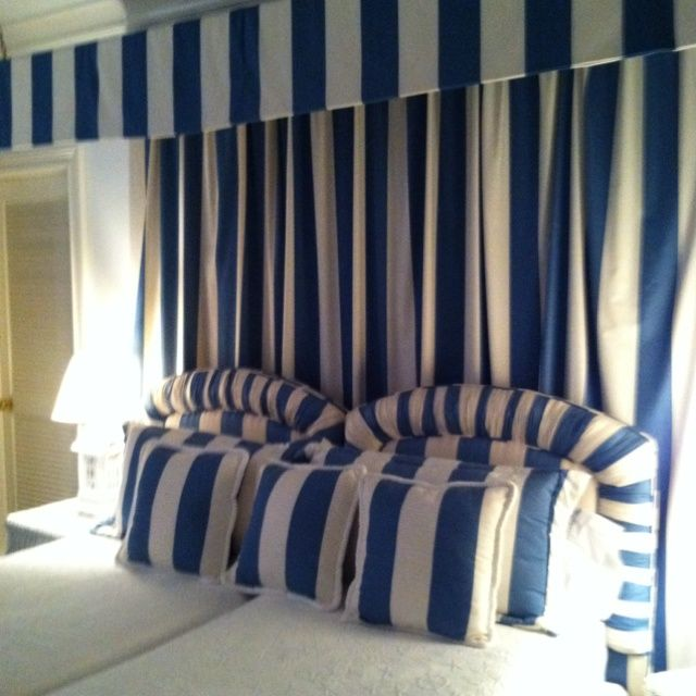 cape cod blue and white striped canopy over guest beds for a beach home by wimberly fair interiors