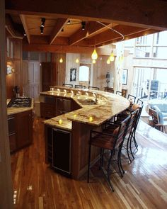 Incroyable Wide Open Kitchen With Bar Seating As Well As Tables. Encourages  Conversation. Kitchen Island