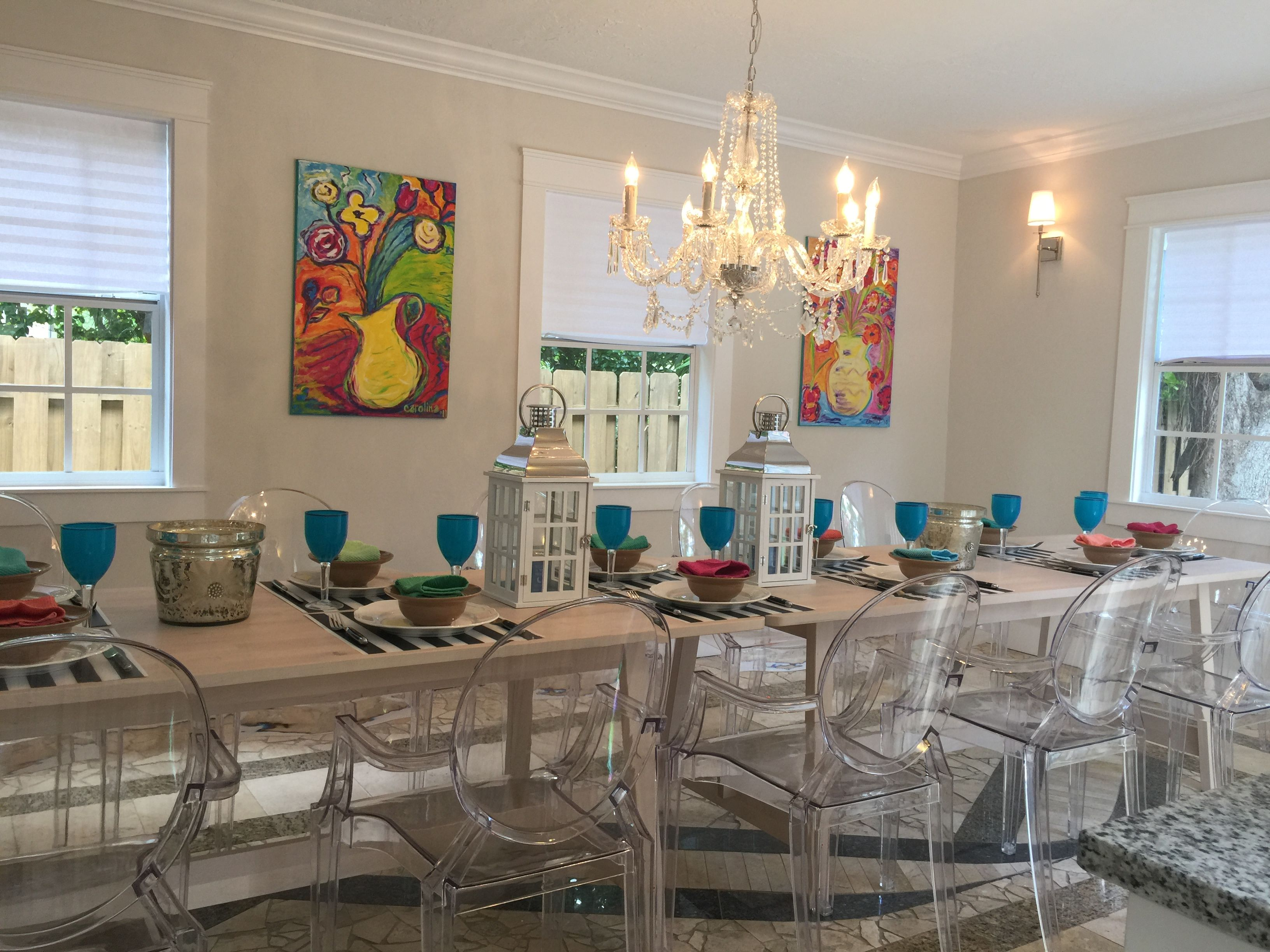 The dining room of our west palm beach home i deliberately chose the dining room of our west palm beach home i deliberately chose clear lucite ghost chairs to mimick the luminosity of the crystal chandelier arubaitofo Choice Image