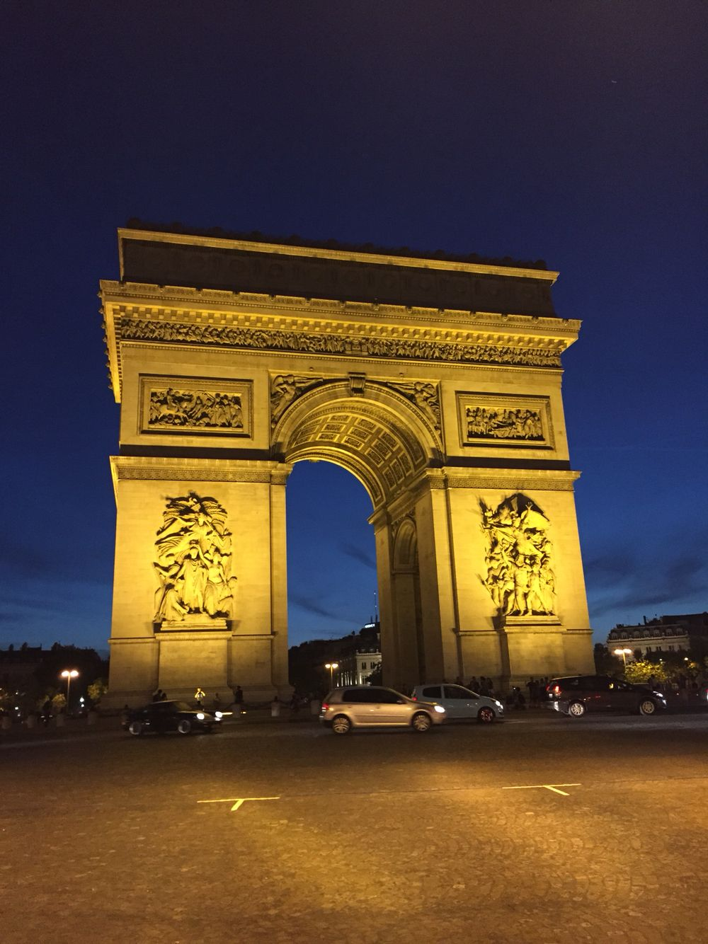 Incredible night view of the Arc de Triomphe on the Champs-Élysées.
