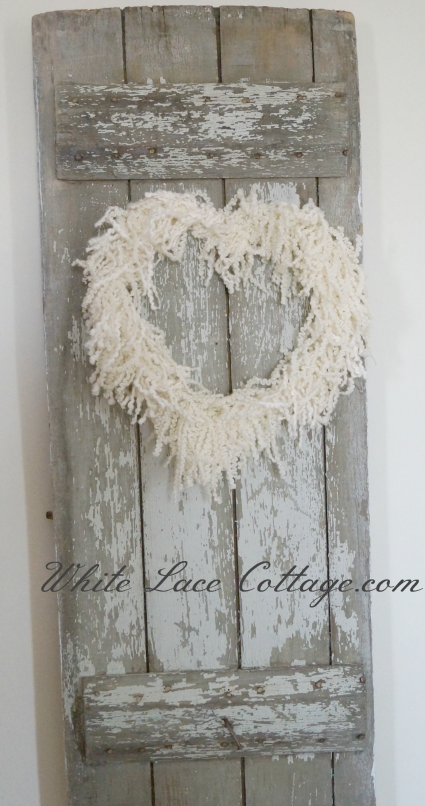 "barn doorheart wreath from White Lace Cottage. Not sure if I can find that ""dizzy frizzy"" yarn she speaks of though."