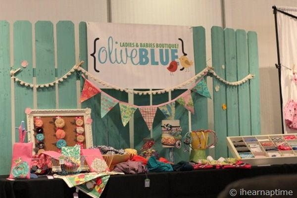 teal fence background - gives booth a pop of color