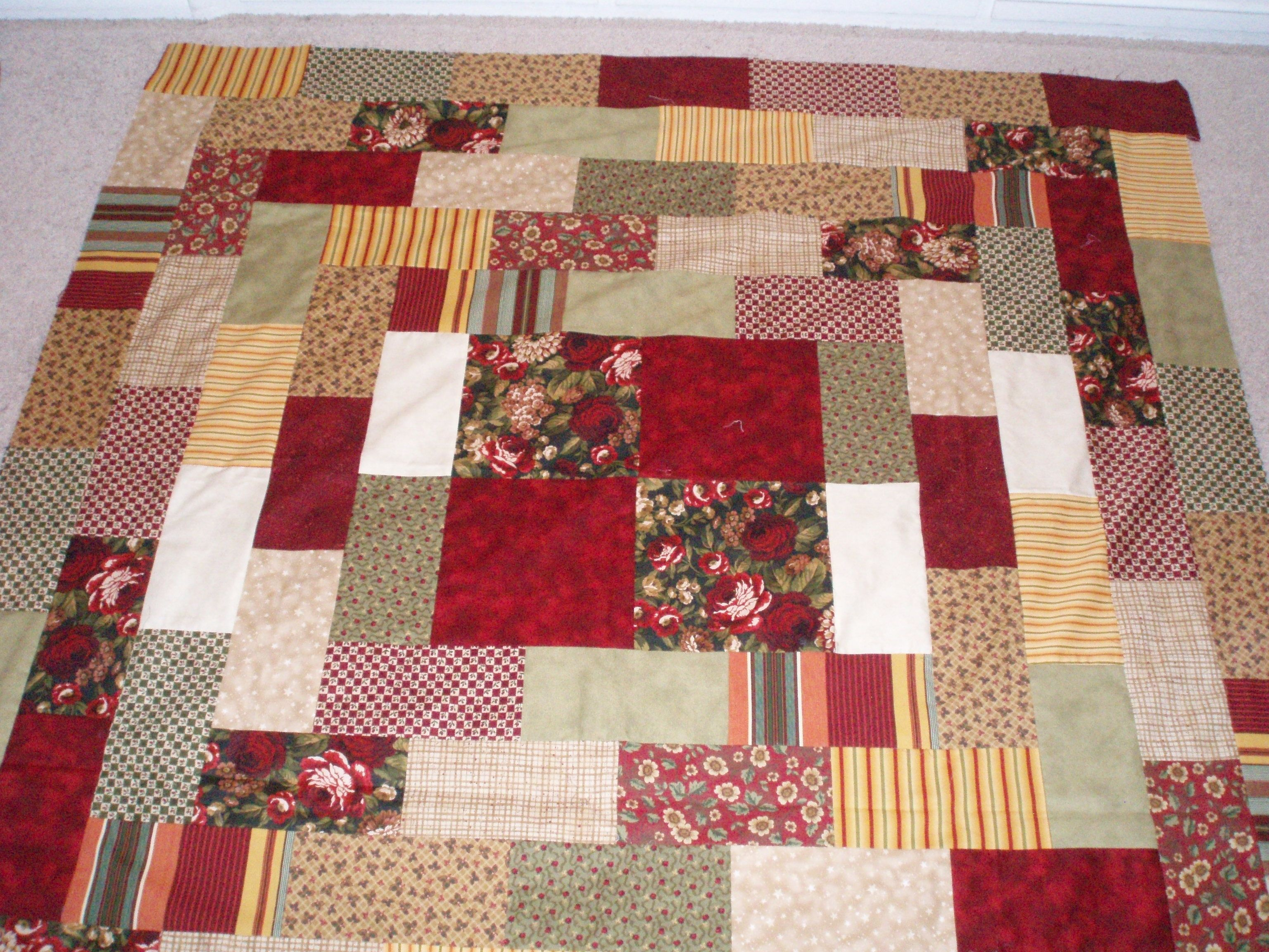 Quilt I made with Reds and Creams love the colors together!