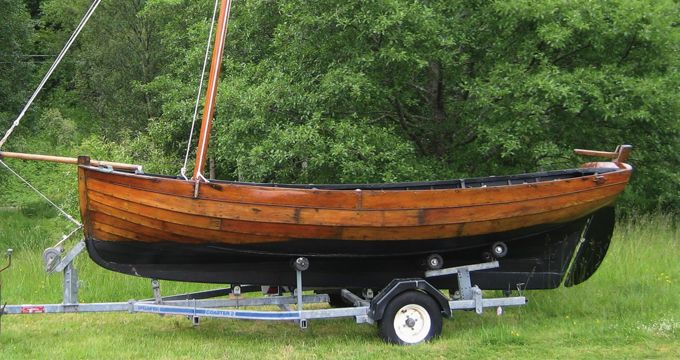 15ft West Highland Skiff.  Reputed to be 100 years old in 1947, this is a genuine antique West Highland Skiff which sails well, and is in excellent condition for its age.