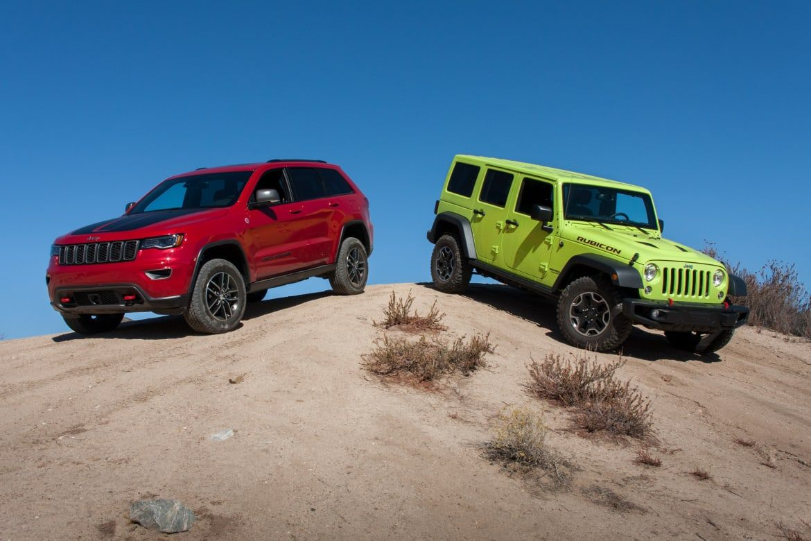 Ultimate Jeep Head To Head Wrangler Rubicon Versus Grand Cherokee Trailhawk News From Cars Com Cherokee Trailhawk Grand Cherokee Trailhawk Wrangler Rubicon