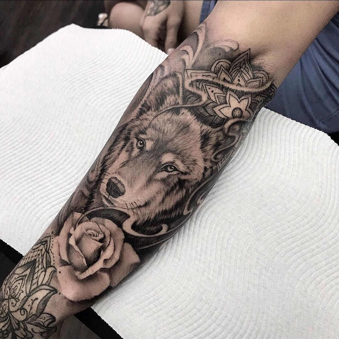 Wolf and rose tattoo