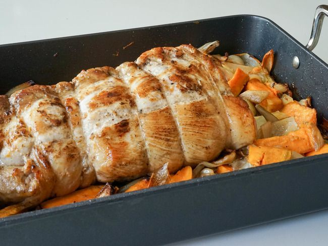 Photo of Roast pork. In controlled cooking with roasted sweet potatoe…
