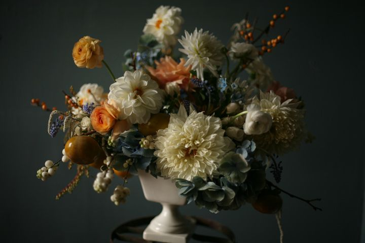 cream, yellow and blue flower centerpiece with dahlias, ranunculus, hydrangeas and berries | Amy Merrick
