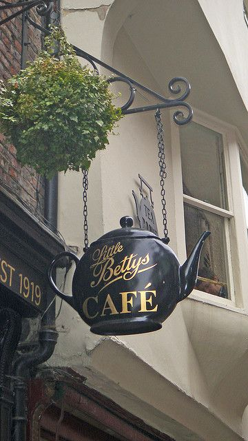 """""""Little Betty's"""" Cafe rounded black teapot sign.  Gift Shop Magazine  www.giftshopmag.com"""