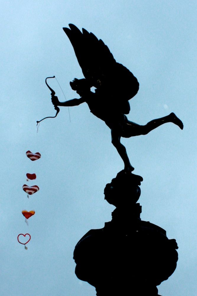 Eros, 8 metres above London, with a string of yarn-bombed, handmade hearts on Valentine's Day.