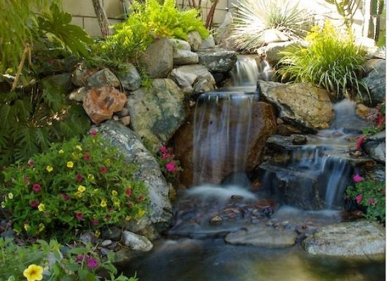 Waterfall for garden ponds austin 39 s landscape ideas for Garden pond ideas pinterest