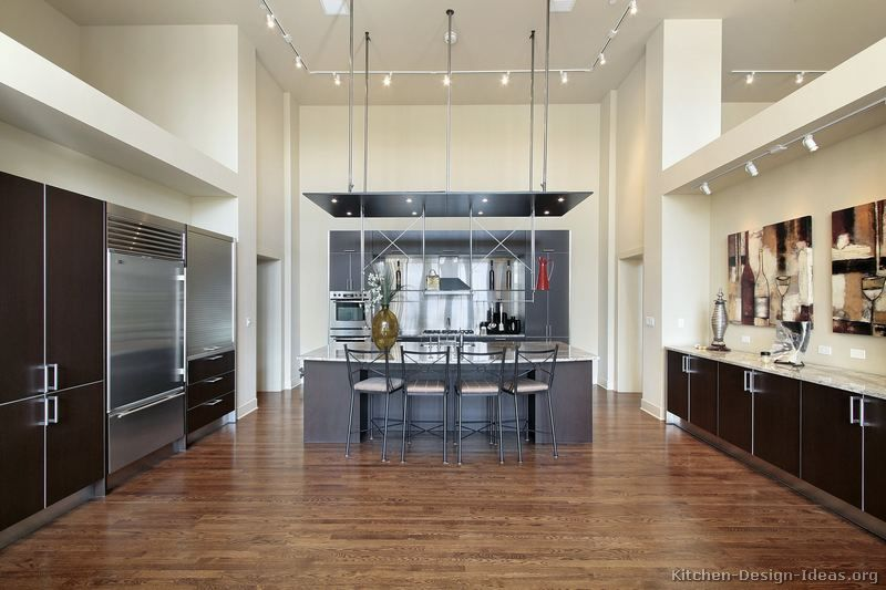 Dark Wood Modern Kitchen kitchen idea of the day: a massive modern kitchen with very high