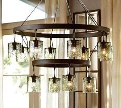 Rhone glass tiered chandelier wrought iron chandeliers spanish modern spanish style wrought iron chandelier pottery barn mozeypictures Image collections
